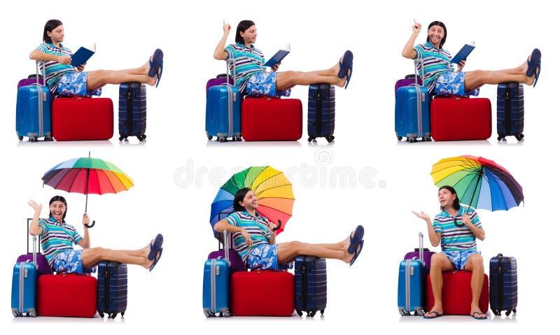 Путешественник с красными случаем и зонтиком стоковое изображение