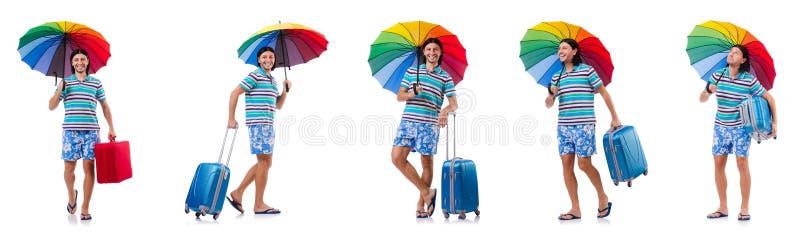 Путешественник с красным случаем и зонтик изолированный на белизне стоковые изображения