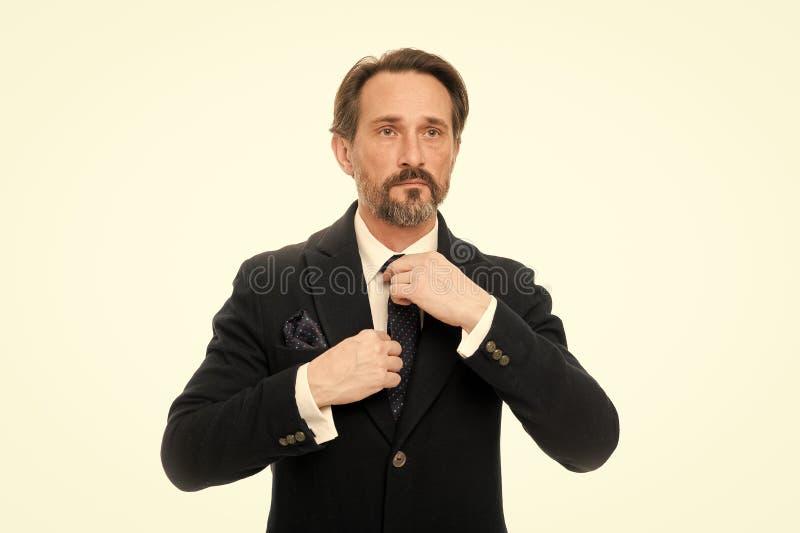 Пути accessorize ваш костюм Bespoke листобиты костюма каждый владелец Костюм вдохновляет чувство доверия джентльмена r стоковые фотографии rf