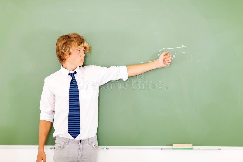 Пушка мальчика школы стоковое фото rf