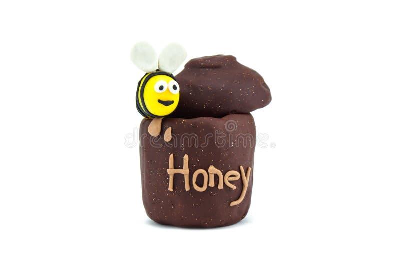 Пчела и мед пластилина стоковые изображения rf