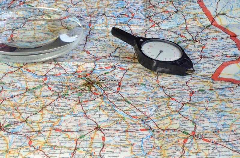 Планируя перемещение на карте стоковое изображение