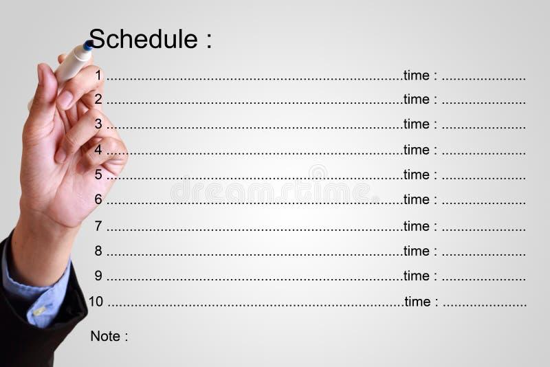 План-график сочинительства бизнесмена с временем стоковое изображение rf