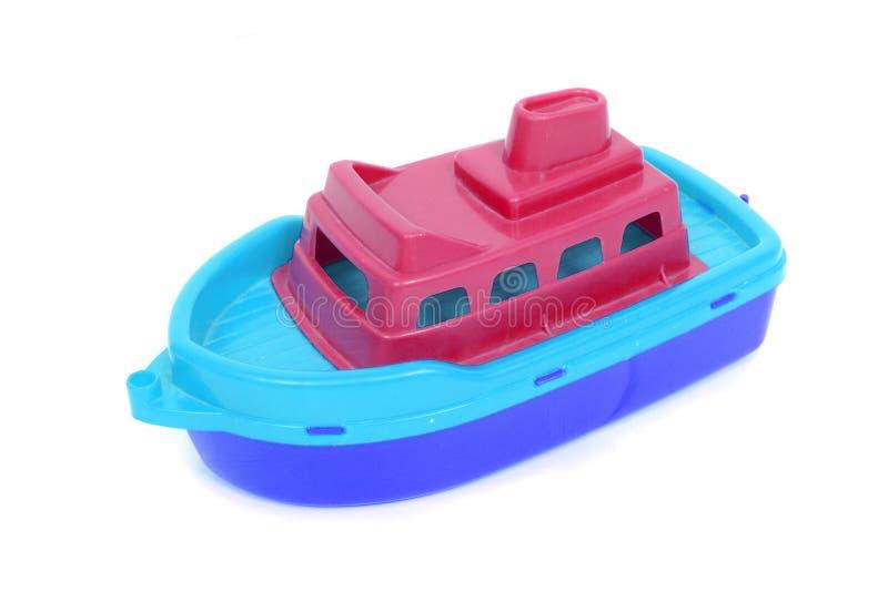 Пластичная шлюпка игрушки стоковое фото