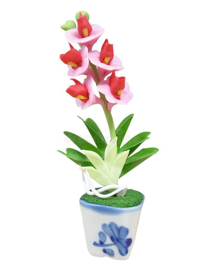 Пластичный цветок с белой предпосылкой стоковое фото rf
