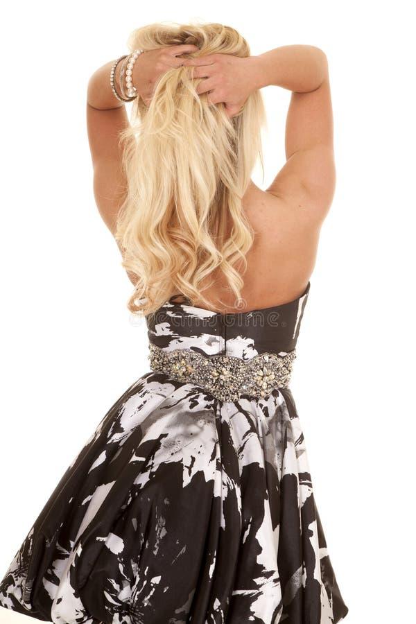 Платье белокурой черноты женщины белое назад стоковая фотография rf