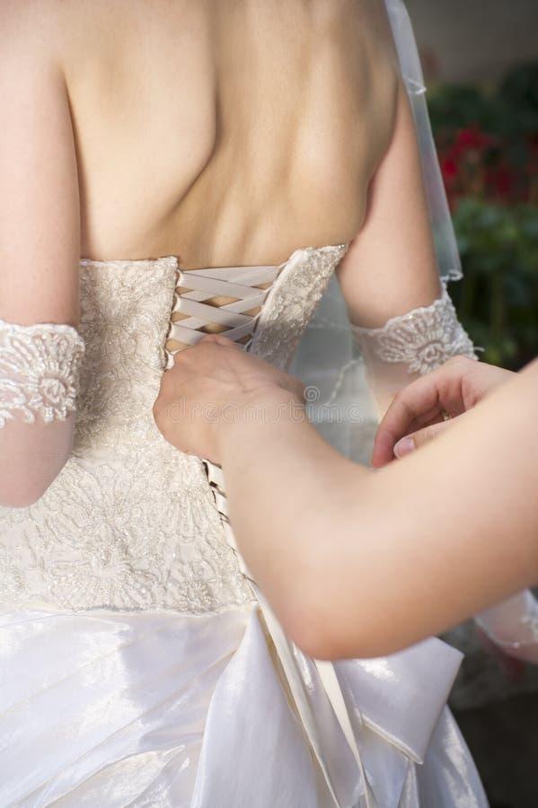 Платья невест роскошного корсета белые стоковое изображение rf