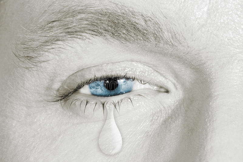 Плача голубой правый глаз стоковые фото