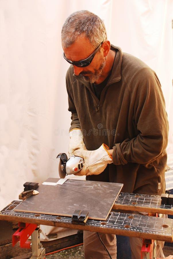 Плитка пола вырезывания построителя стоковые фотографии rf