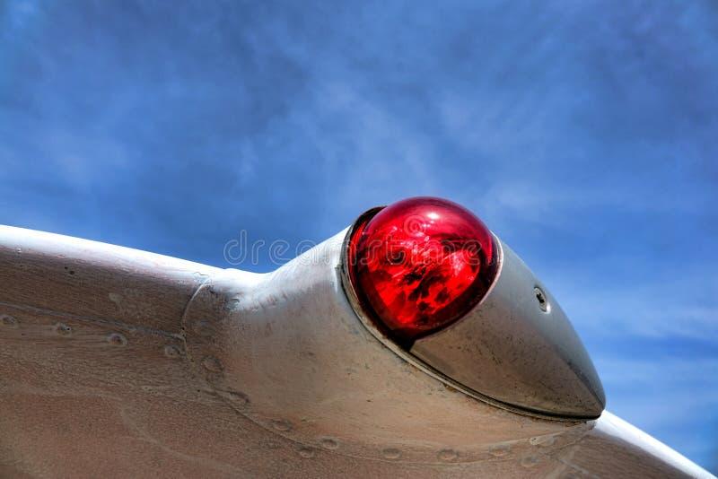 Плоская отметка положения красного света навигации левого крыла стоковые фото