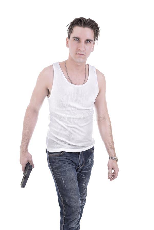 Плохой парень держа личное огнестрельное оружие стоковое фото rf