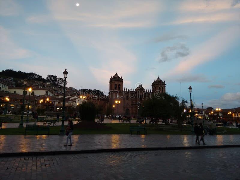 Площадь Cuzco захода солнца стоковые изображения