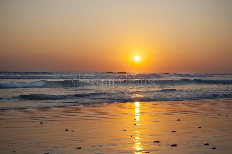 Пляж захода солнца стоковые фото