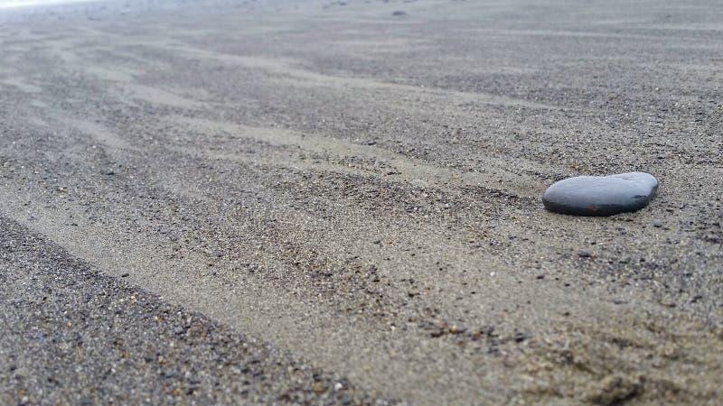 Пляж и камень стоковое фото rf