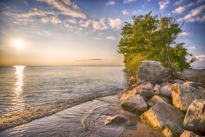 Пляж национального парка Pelee пункта на заходе солнца стоковые фотографии rf