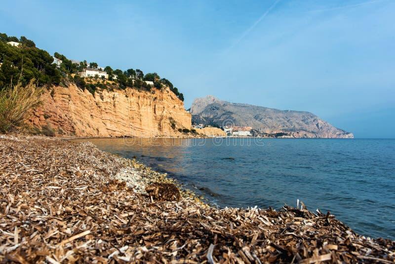 Пляж нудиста Solsida около городка Altea стоковые фотографии rf
