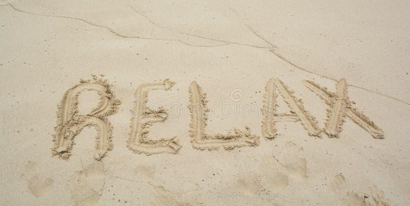 пляж ослабляет слово стоковое изображение