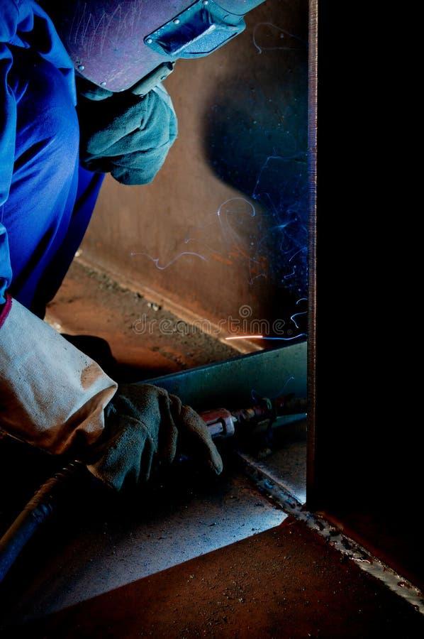 Работайте работники заварки в фабриках стоковое фото