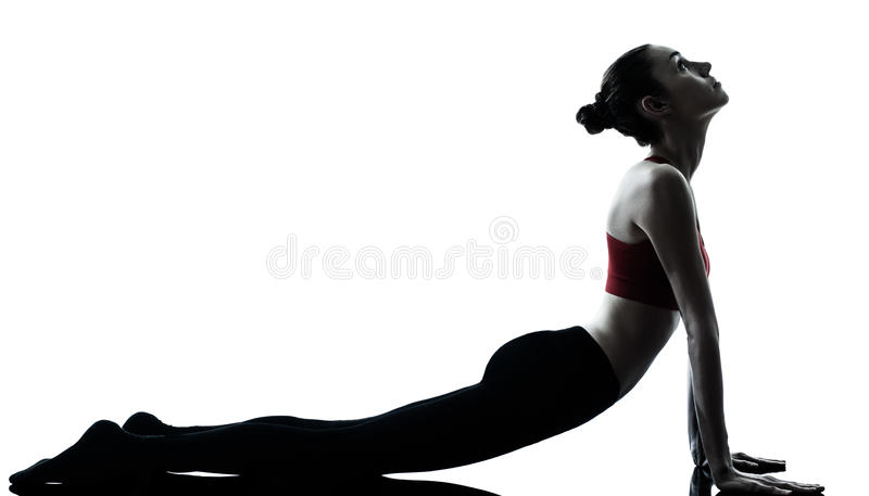 работать йогу женщины солнца salutation стоковые фото