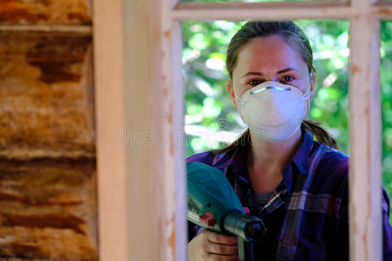 Работая молодая женщина стоковое фото rf