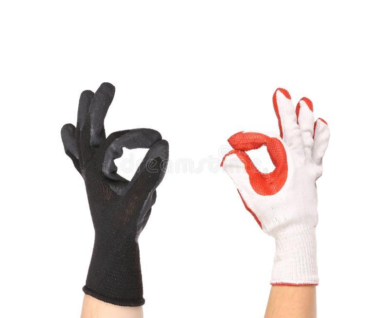 Работая руки в перчатках стоковое изображение