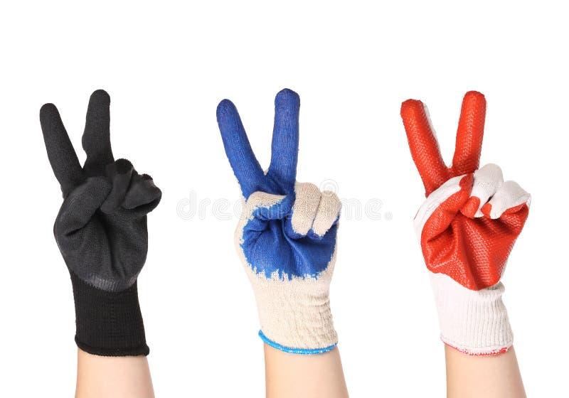 Работая руки в перчатках стоковые изображения
