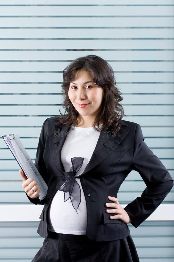 работа беременной женщины стоковые изображения