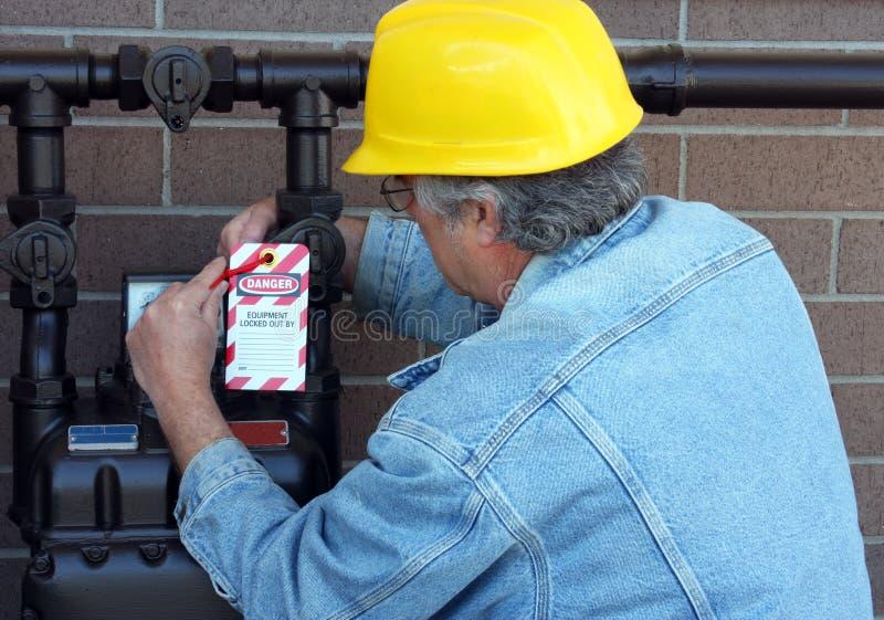 работники бирки опасности конструкции стоковое фото