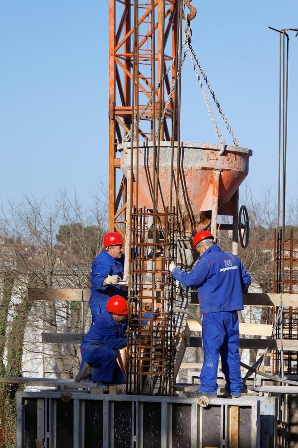 Работники здания конструкции стоковые фото