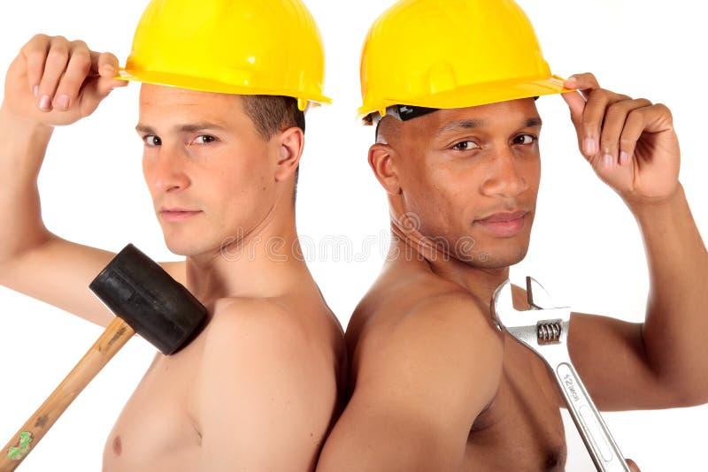 работники конструкции сексуальные стоковая фотография rf