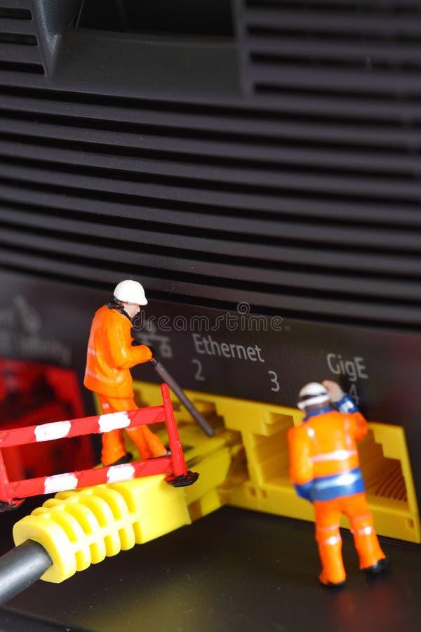 Работники a маршрутизатора миниатюрные модельные стоковое фото