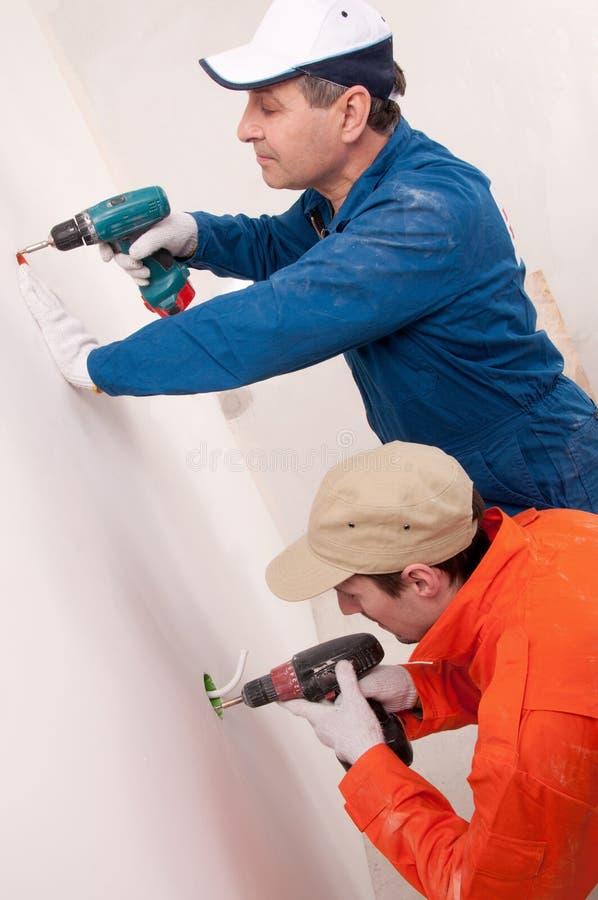 работники строительства стоковое фото