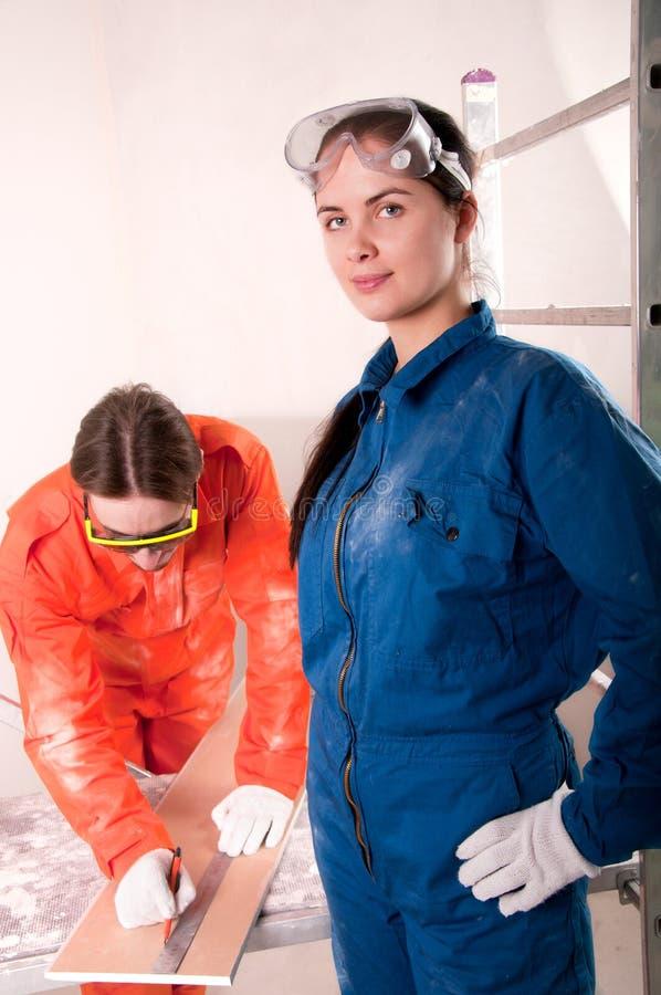 работники строительства стоковое изображение