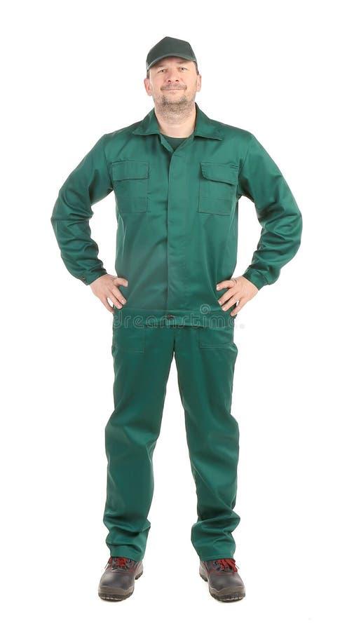 Работник в зеленом workwear. стоковые изображения
