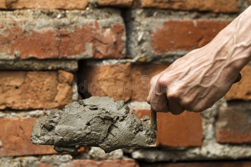 работник инструмента лопаткоулавливателя руки стоковое изображение rf