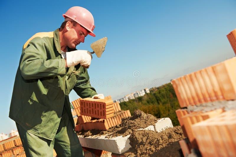работник каменщика конструкции bricklayer стоковое фото