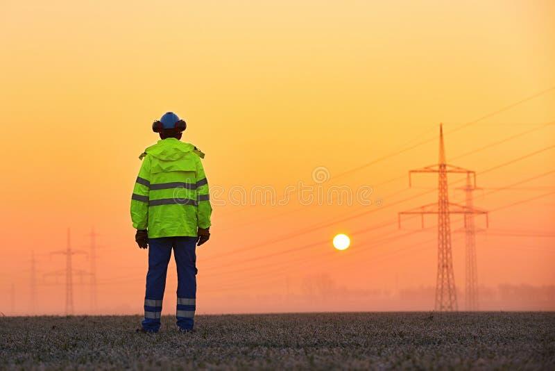 Работник на восходе солнца стоковая фотография rf