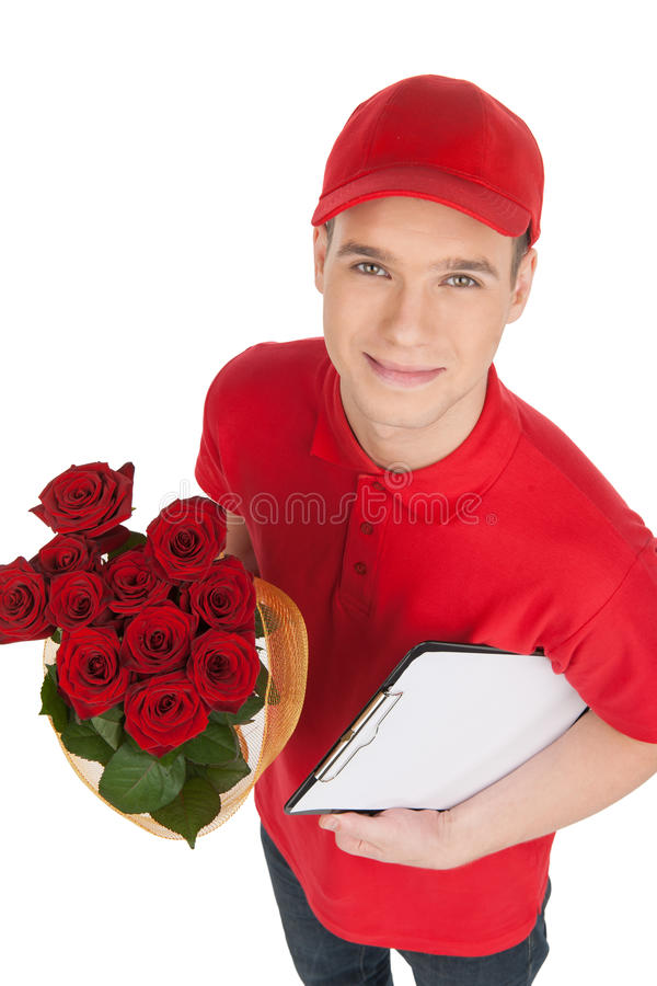 Работник доставляющее покупки на дом с цветками. Взгляд сверху работника доставляющего покупки на дом держа bunc стоковые фотографии rf