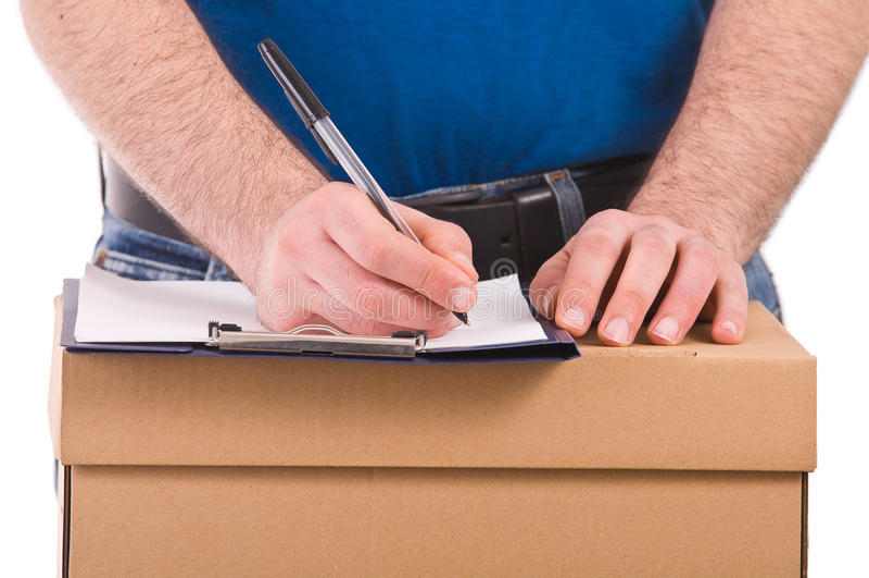 Работник доставляющий покупки на дом. стоковая фотография