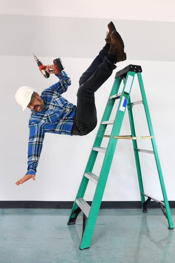 Работник падая лестница стоковое изображение rf