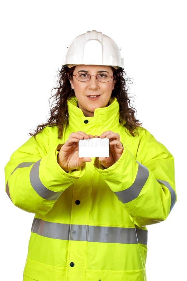 работник удерживания одного конструкции пустой карточки женский стоковое изображение