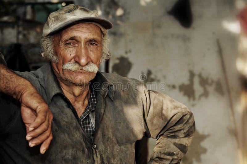 работник portait положения хуторянина востоковедный стоковые изображения