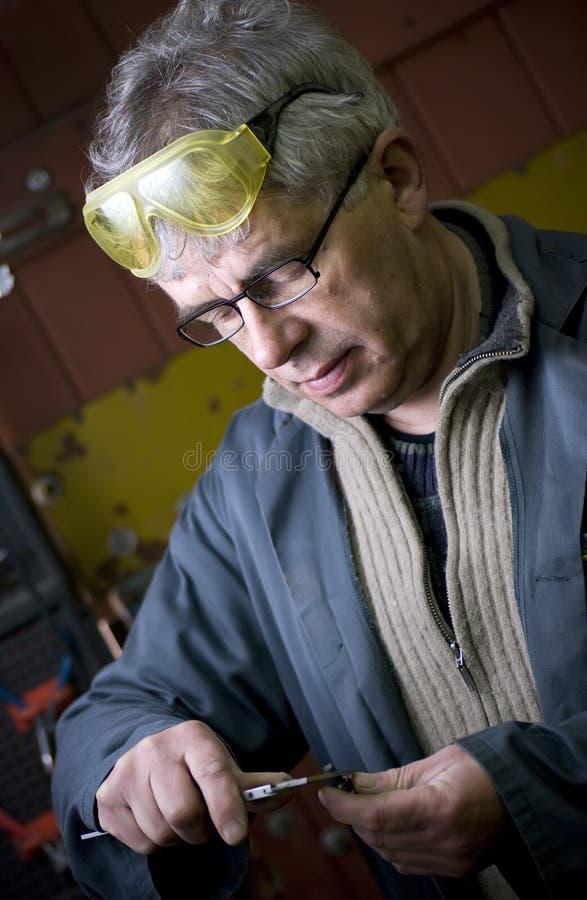 рабочий класс старшия портрета стоковое фото