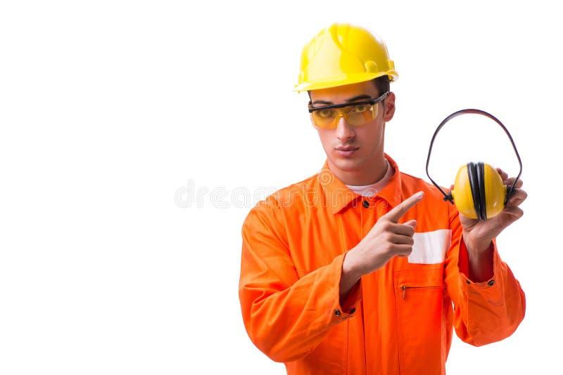 Рабочий-строитель при шум отменяя наушники стоковая фотография rf