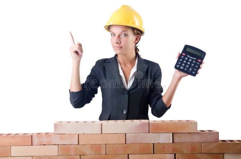 Рабочий-строитель женщины с калькулятором стоковые фотографии rf