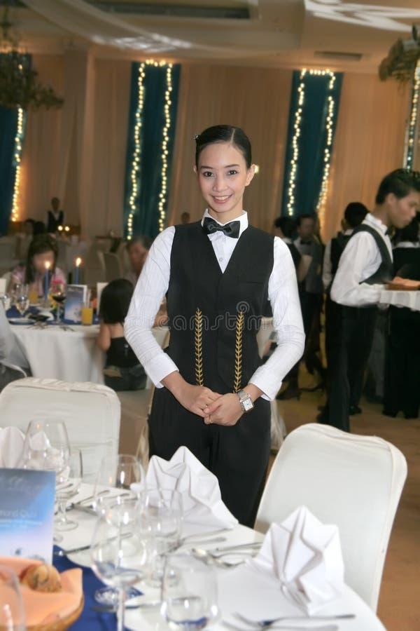 равномерная официантка стоковое фото rf