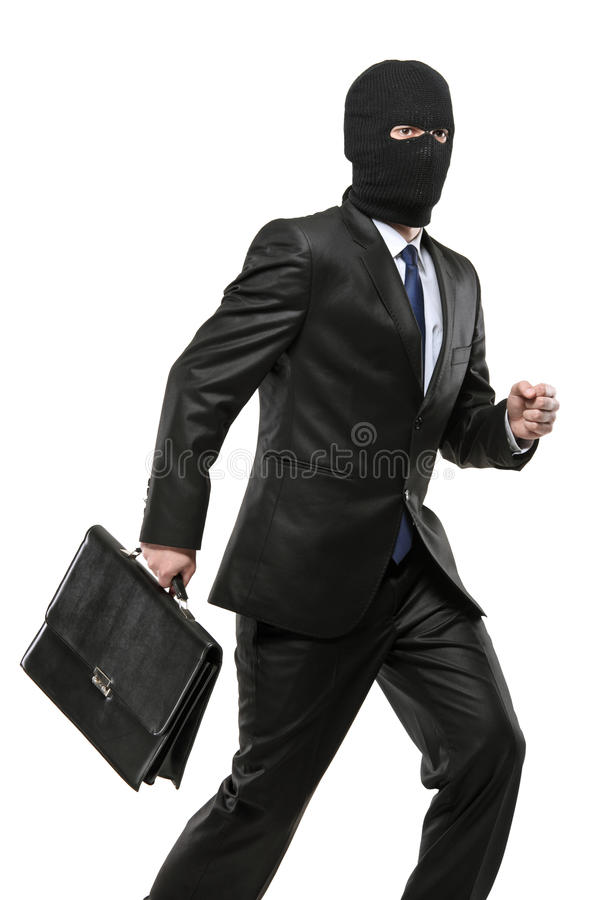 разбойничество нося маски человека портфеля стоковая фотография rf