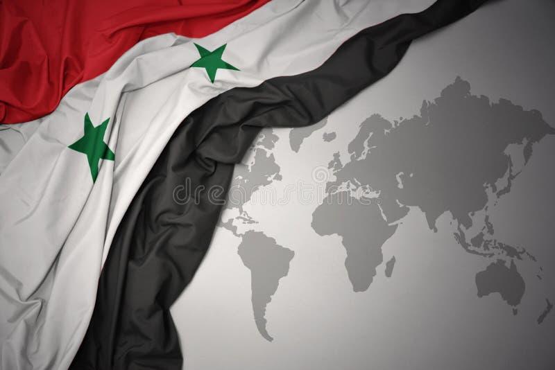 Развевая красочный национальный флаг Сирии стоковое фото