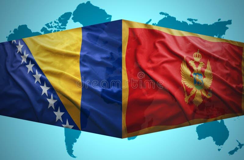 Развевая флаги Montenegrin и боснийца стоковая фотография