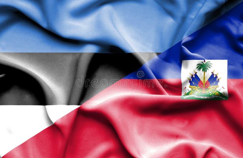 Развевая флаг Гаити и Эстонии стоковая фотография rf